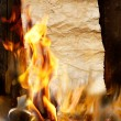 Ancient scroll on burns in the fire — Stock fotografie