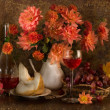 Still life with autumn flowers, melon, grapes and wine — Stock Photo #2465537