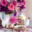 Still Life with flowers and tea - Stock Photo