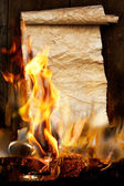 Ancient scroll on burns in the fire — Stock Photo