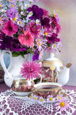 Still Life with flowers and tea — Stock Photo