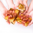 Hands and gifts - Stockfoto