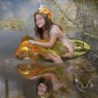 Girl elf and  gold fish - Stock Photo