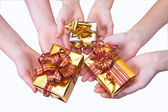 Hands and gifts — Stock Photo