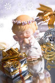 Gifts and angel christmas — Stock Photo