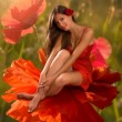 Brunette sitting in a flower — Stock Photo