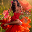 图库照片: Brunette with wings sitting in flower