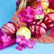 Stock Photo: Basket full of Easter eggs and flower