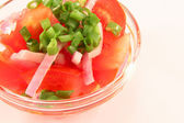 Salad from tomatoes and onions — Stock Photo