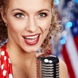 Stock Photo: Singer woman, pin-up style