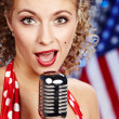 Singer woman, pin-up style — Stock Photo #1597222