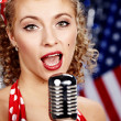 Singer woman, pin-up style — Stock Photo #1597350