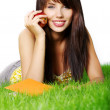Woman lays on green grass — Stock Photo