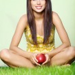 Woman with red apple — Stockfoto #1601309