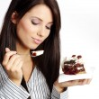 Young beautiful woman with a cake. — Stock Photo