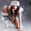 Winter wild woman on snow and grey — Stock Photo