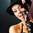 Singer with the retro microphone — Stock Photo #1605158