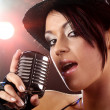 Stock Photo: Singer with the retro microphone