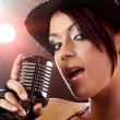 Singer with the retro microphone - Stock Photo