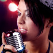 Stock Photo: Woman singer with the retro microphone