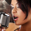 Singer woman with the retro mic — Stock Photo #1605208