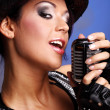 Singer with the retro microphone — Stock Photo #1605263