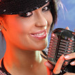 Singer with the retro microphone — Stock Photo #1605333