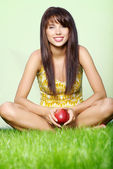 Woman with red apple — Stockfoto