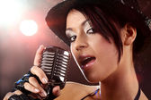 Singer with the retro microphone — Stock Photo