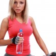 Sporty female sitting with water — Stock Photo