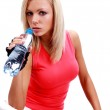 Sporty female sitting with water — Stock Photo #1626881