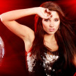 Girl dancing over mirror ball background - Stockfoto