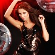 Girl dancing over mirror ball background — Stok fotoğraf
