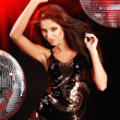 Girl dancing over mirror ball background — Stock Photo #1629991