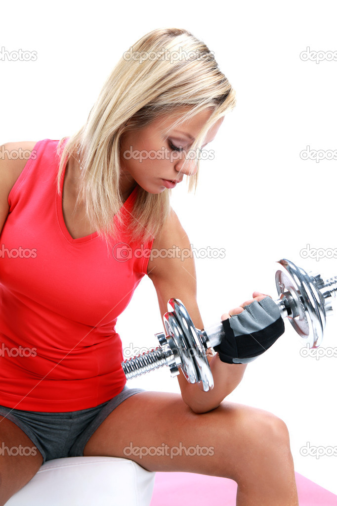 A photo of a woman lifting a weight — Stock Photo #1627805