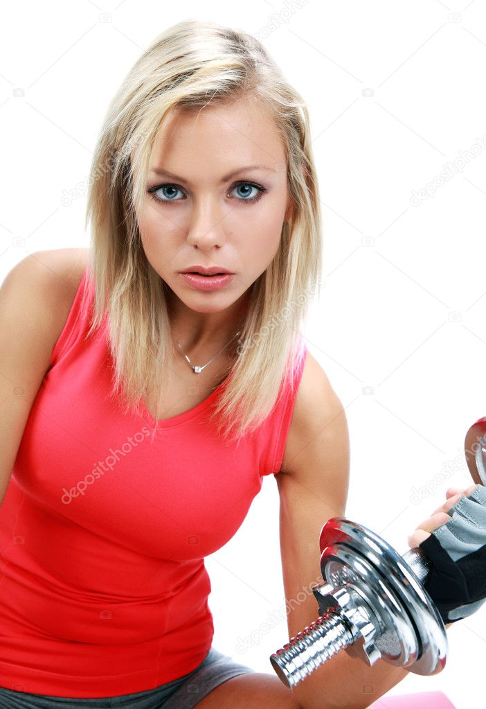 A photo of a woman lifting a weight — Stock Photo #1628120