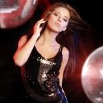 Girl dancing over mirror ball background — Stock Photo