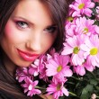 Woman with flowers — Stock Photo #1656398