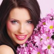 Woman with flowers — Stock Photo #1656434