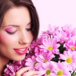 Woman with flowers — Stock Photo #1656515