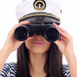 Woman looking through binoculars — Stock Photo #1656957