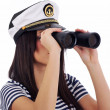 Woman looking through binoculars — Stock Photo #1656958