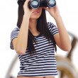 Womlooking through binoculars — Stock Photo #1656993