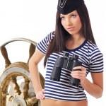 Woman looking through binoculars — Stock Photo #1657245