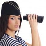 Woman looking through binoculars — Stock Photo #1657274