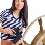 Woman looking through binoculars — Stock Photo #1657325