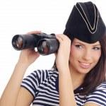 Woman looking through binoculars — Stock Photo #1657328