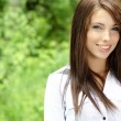 Beautiful young woman outdoors — Stock Photo #1658002