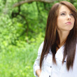 Stock Photo: Beautiful young woman outdoors