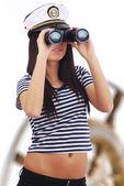 Woman looking through binoculars — Stock Photo